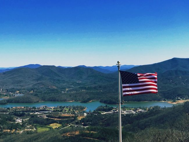 Patriotic America American Flag Flag Patriotism Striped Flag Pole Blue Stars And Stripes Mountain Landscape Clear Sky Pride Outdoors Mountain Range Beauty In Nature Nature Sky