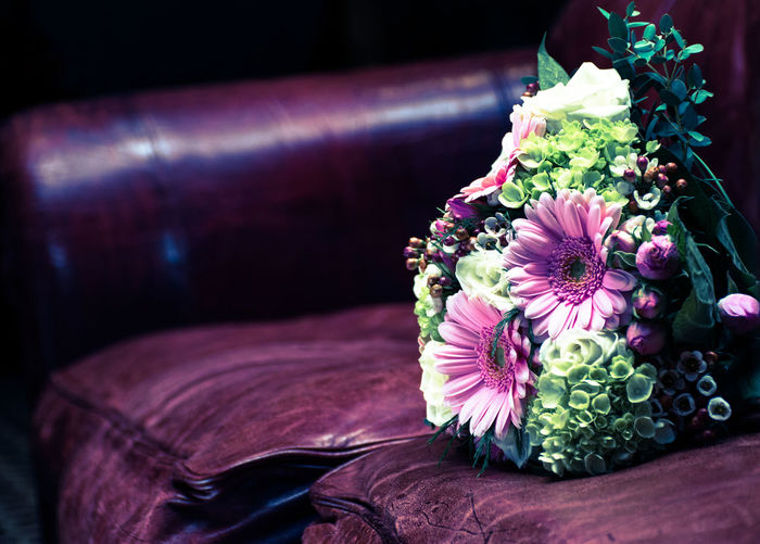Close-up of flower bouquet on sofa