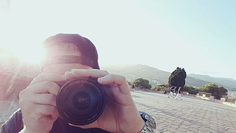 Photography Themes Camera - Photographic Equipment Young Women Photographing SLR Camera Portrait Technology Clear Sky Beach Photographer