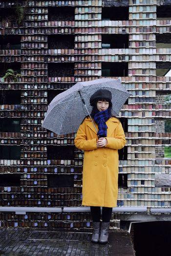 Colors Rainy Days Wall Brick Umbrella One Person Standing Lifestyles Architecture Leisure Activity Front View Built Structure Portrait