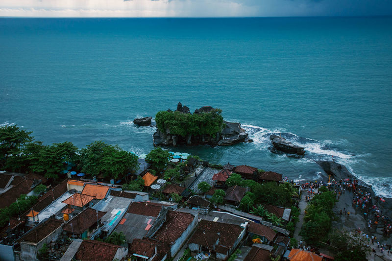 High angle view of sea and buildings against sky