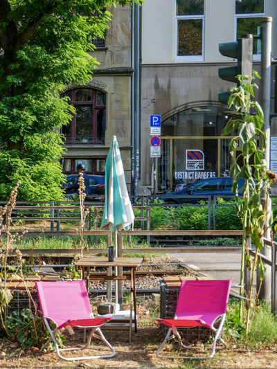 URBANANA #urbanana: The Urban Playground Absence Architecture Available Light Building Building Exterior Built Structure Chair Day Empty Glass - Material Grass Growth Land Nature No People Outdoors Plant Seat Streetphotography Table Transparent Tree