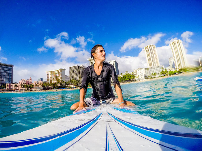 Hawaii Oahu Travelling Hawaii Me Oahu Oahu, Hawaii Adult Adults Only Beach Day One Person One Woman Only Outdoors People Portrait Real People Sky Surfing Surfingphotography Swimming Pool Water Young Adult Stories From The City EyeEmNewHere