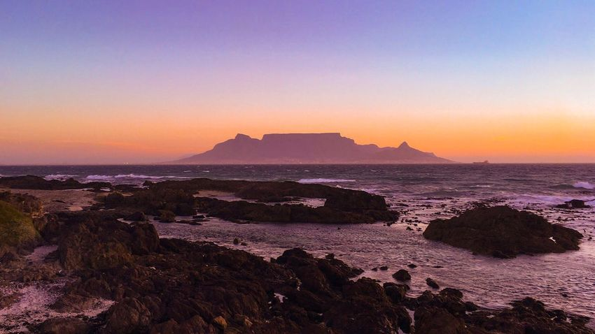 Scenics Capetown South Africa Sea Nature Beauty In Nature Sunset Horizon Over Water Rock - Object Tranquil Scene Tranquility Table Clear Sky African Sunset African Skies Table mountain seen from Blouberg Strand at sunset Been There. Connected By Travel