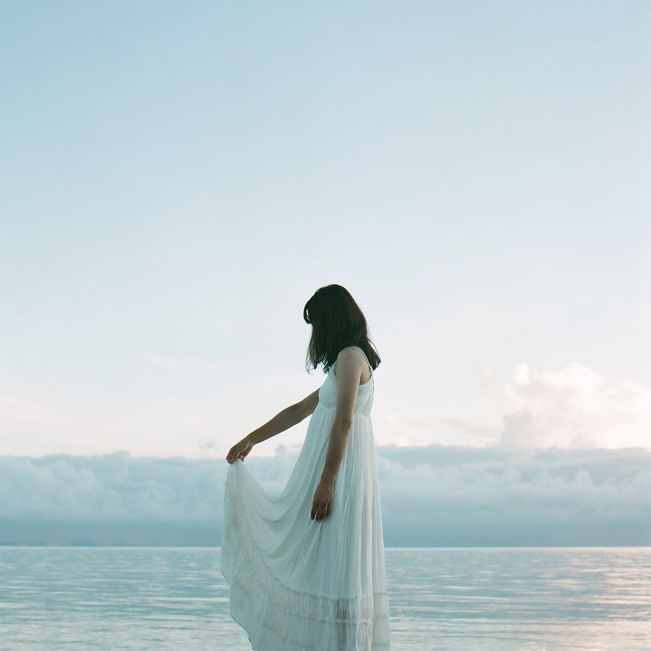 sea, water, horizon over water, sky, standing, copy space, nature, beauty in nature, day, outdoors, scenics, tranquil scene, cloud - sky, women, wedding dress, one person, real people, beach, young adult, bride, young women, people