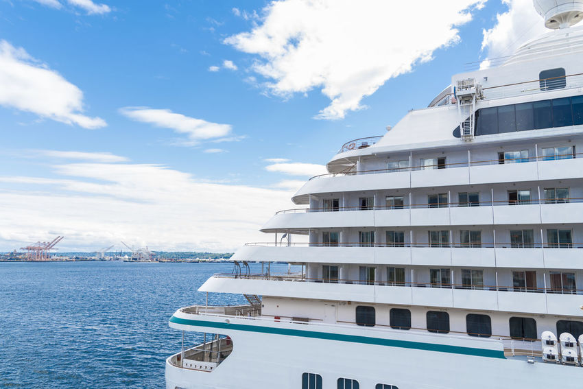 Back end of cruise ship at sea sailing away from port Apartment Architecture Boat City Day Decks Getaway  Leisure Activity Luxury Mode Of Transport Nature Nautical Vessel No People Outdoors Sailing Sea Sky Transportation Travel, Vacation Views Water Yacht