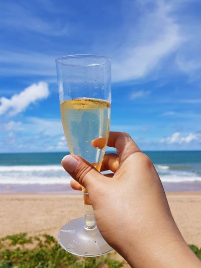 Cheers Enjoying The Sun Enjoying The View Sparkling Wine EyeEm Selects Human Hand Water Sea Beach Drink Alcohol Sand Drinking Glass Cocktail Summer