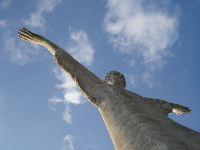 Low angle view of cristo redentore against blue sky