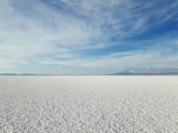 Scenic View Of Salar De Uyuni Against Blue Sky
