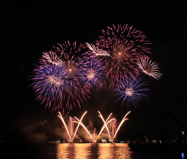 Fireworks display Celebration Exploding Firework Firework - Man Made Object Firework Display Horizontal Illuminated Midnight Multi Colored Night No People Outdoors Reflection Sky Water
