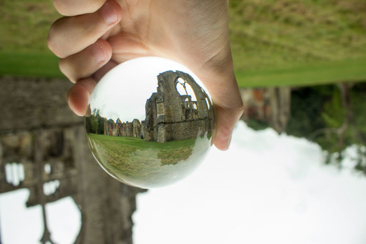 Architecture Close-up Crystal Ball Day Focus On Foreground Holding Human Body Part Human Finger Human Hand Nature One Person Outdoors People Planet Earth Real People Reflection Tree