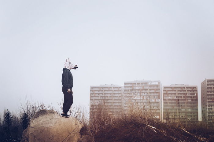 Unicorns will save the. Unicorn Unicorn Mask Unicorn Head Architecture Urban Urban Exploration Mask Mask - Disguise Disguise Conceptual One Person One Man Only One Person Only Man Cold Temperature Day Stories From The City Go Higher
