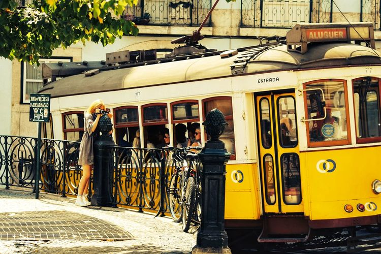 Paint The Town Yellow Mode Of Transport Transportation Day Yellow Public Transportation Land Vehicle Outdoors Stationary Real People People Lifestyles Walking One Woman Only Gerador City Cityscape City View  Lisbon - Portugal Lisbon City Life Lisbontourism Town Town Square Town View Town Street