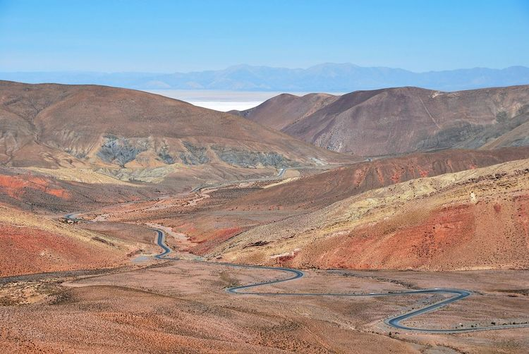 Winding road towards salinas grandes high up in the andes of argentina