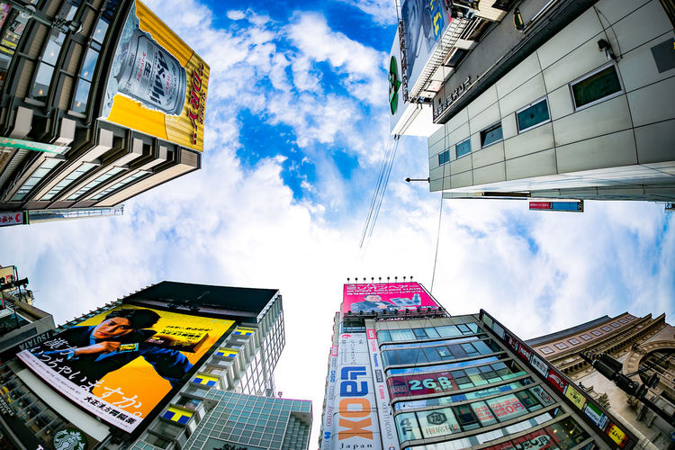 Busy street of Dotonburi, Osaka. Architecture Blue Building Built Structure City City Cityscapes Cloud - Sky Dōtonbori Fisheye FishEyeEm Fresh On Eyeem  Japan Modern OSAKA Osaka-shi,Japan Outdoors People Of EyeEm Sky Street Photography The Great Outdoors With Adobe