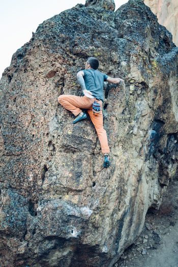 Low section of person on rock