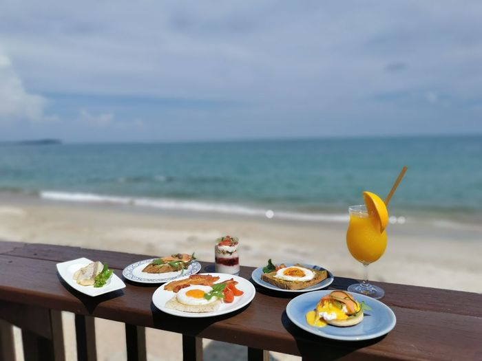 High angle view of breakfast on table against sea