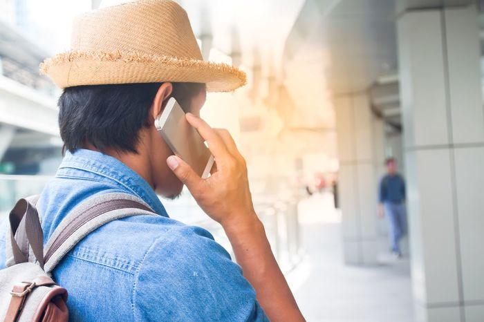 Young asian tourist man using smartphone, Travel and Lifestyle concept Adult Asian  Building Exterior Communication Focus On Foreground Lifestyles Men Mobile Phone One Person Outdoors People Real People Smart Phone Technology Technology Everywhere Using Phone Wireless Technology