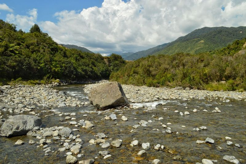 the rolling stone. 😊 Eye4photography  Nature New Zealand Scenery Walking Around EyeEm Best Shots EyeEm Nature Lover Nature Photography Tadaa Community Kiwi Clicker Photography River The Great Outdoors - 2018 EyeEm Awards Naturelovers NZ Nzscenery Valley Lush Foliage Hills Riverside Clouds And Sky Stones Valley Tree Mountain Rock - Object Sky Landscape Cloud - Sky Mountain Range Stone - Object