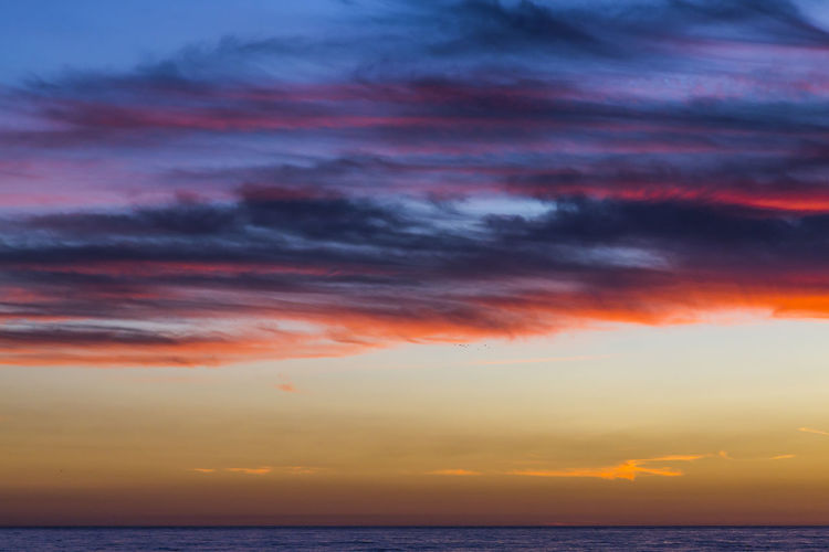 California Colors Gradient Nature Sky And Clouds Beauty In Nature Cloud - Sky Clouds And Sky Colorful Day Dramatic Sky Horizon Horizon Over Water Idyllic Nature Ocean Orange Color Outdoors Scenics - Nature Sea Sky Sunset Tranquil Scene Tranquility Water