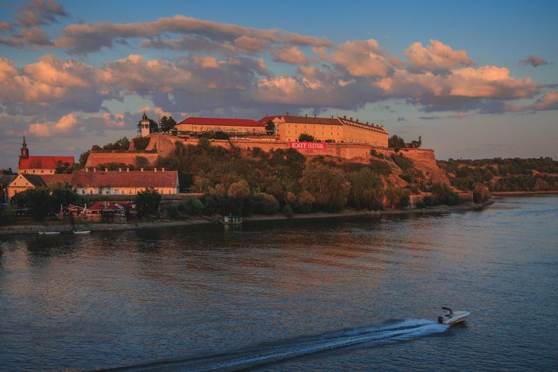 City novisad Serbia Novi Sad Castle Balkan Building Exterior Sky Architecture Built Structure Cloud - Sky Water Sunset River Waterfront Outdoors City Building Dusk