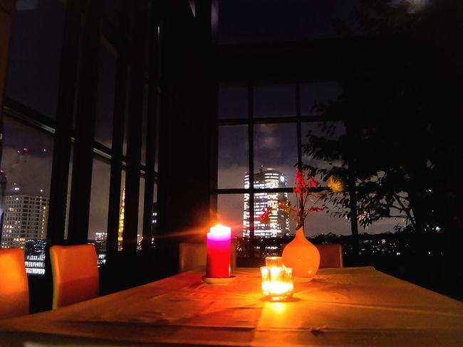 A room with a view Cityscape City Life Cityscape Romantic Table Setting Illuminated Candle Glass - Material Night Window Lighting Equipment Architecture Built Structure Glowing