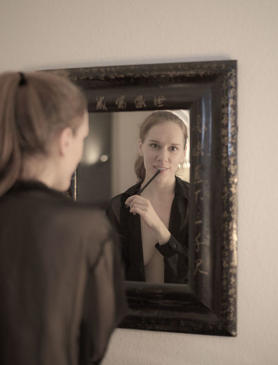 Beautiful Girl Getting Ready Looking At Camera Makeup Reflection Treat Yourself At The Mirror Cannot Decide Makup Erotic_model Focus On Foreground Getting Ready For Date Night Happyness Intimate Moment Open Shirt Preparing For A Date Sexygirl Smiling Take Time For Yourself