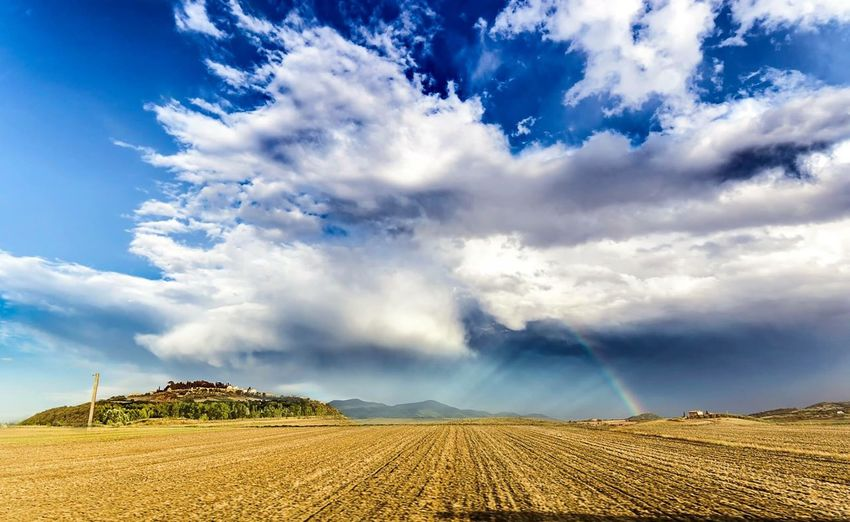 Sky Cloud - Sky Beauty In Nature Tranquil Scene Tranquility Scenics - Nature Land Plant Rural Scene No People Field Sunlight Agriculture Nature Blue Growth Landscape Environment Day Idyllic