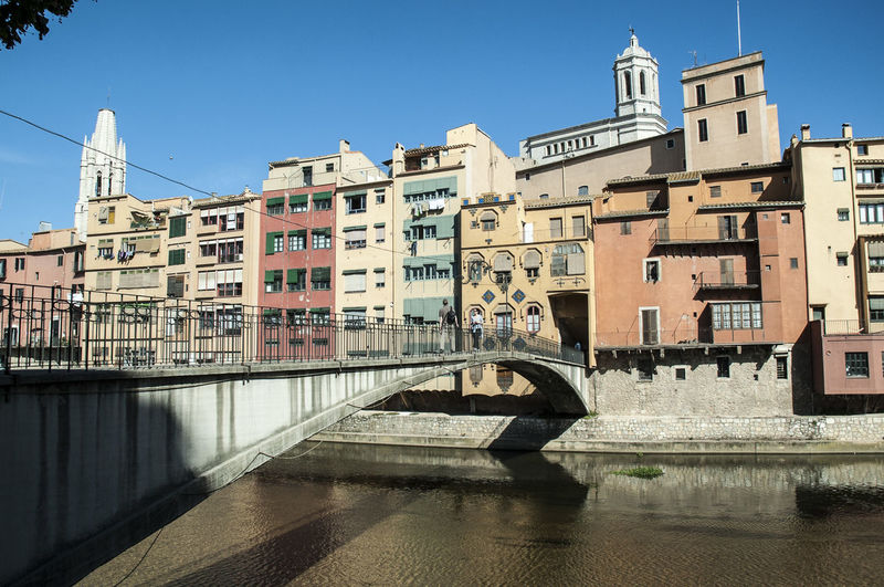 Girona Architecture Bridge - Man Made Structure Building Exterior Built Structure Canal City Clear Sky Connection Day No People Outdoors Rosafrancomendoza Sky Sunlight Travel Destinations Water Waterfront