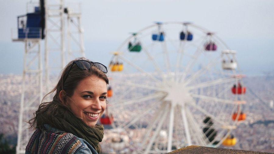 Close-up portrait of smiling woman at amusement park