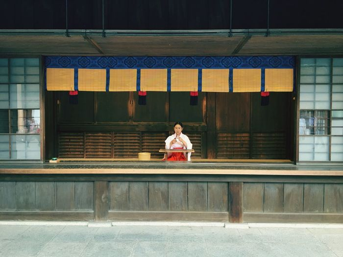 Miko. (Shrine maiden) Shrine Maiden Temple Japan Shrine Shrine Of Japan Miko Shinto Shinto Shrine Real People One Person Sitting Architecture Women Lifestyles Travel