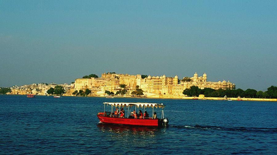 Sailing away next to City Palace Udaipur