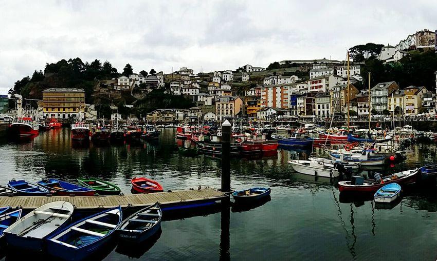 Asturias SPAIN Puerto Port Colors Village Pueblo Cellphone Fisherman Fishing