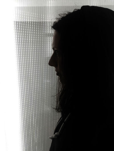 Portrait of young woman looking away at home