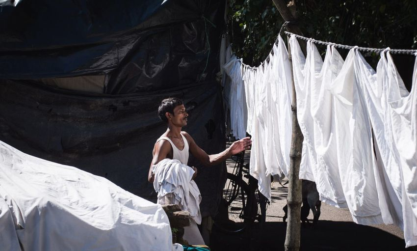 Man drying clothes outdoors