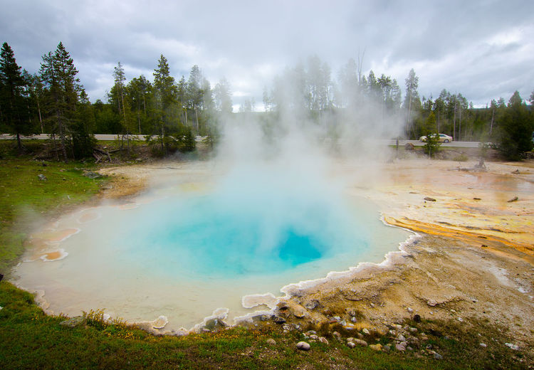View of geyser on landscape