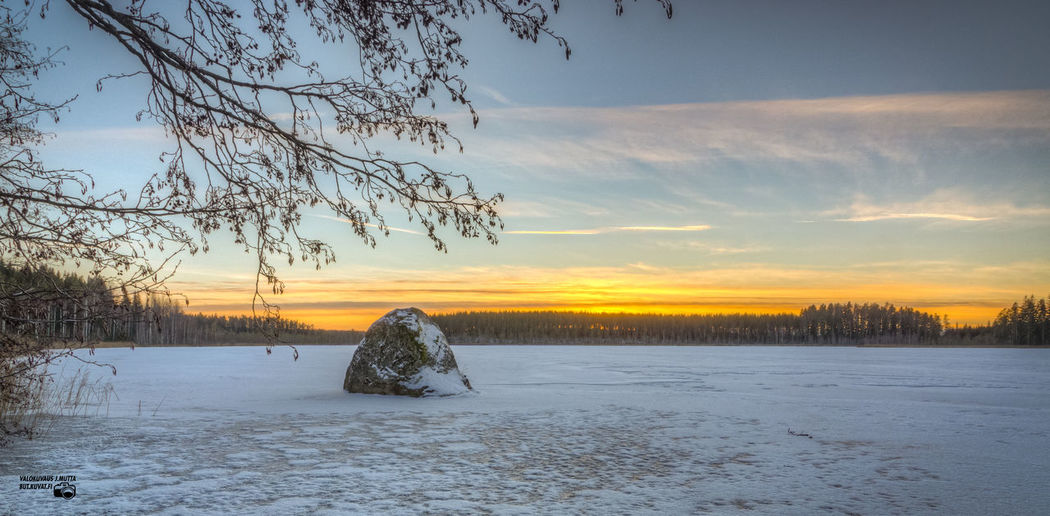 Sunset at small frozen forest lake. Beauty In Nature Cloud - Sky Cold Temperature Ice Nature No People Outdoors Scenics Sky Snow Sunset Sunset #sun #clouds #skylovers #sky #nature #beautifulinnature #naturalbeauty #photography #landscape Tree Winter