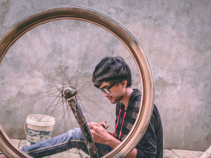Young man repairing bicycle