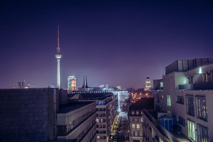 Fernsehturm In City Against Sky At Night