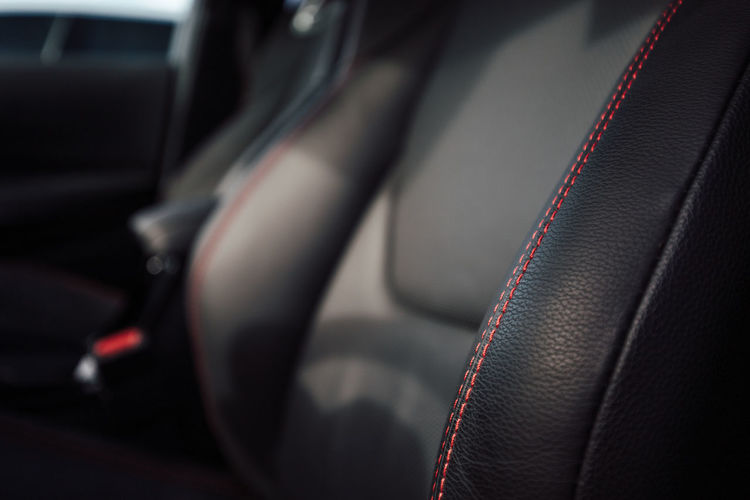 Close-up of red seats in car