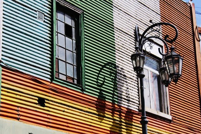 Building Exterior Window Outdoors Architecture Low Angle View Shutter Built Structure Street Light No People Day Illuminated Multi Colored City Sky Caminito, Buenos Aires Buenos Aires Street Argentina🇦🇷 Travel Destinations City Architecture Stories From The City Go Higher Inner Power EyeEmNewHere Summer Exploratorium Visual Creativity