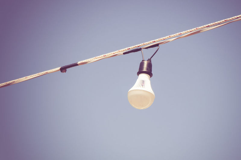 Low angle view of light bulb against clear sky