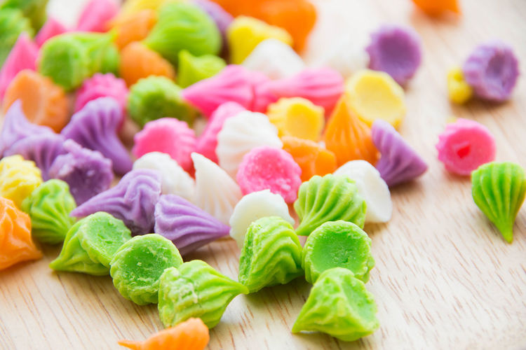 Close-Up Of Multi Colored Candies On Table