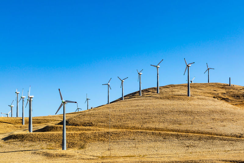 Wind turbines on the hills at Altamont Pass, in California, with morning light Fuel And Power Generation Sky Wind Turbine Turbine Alternative Energy Wind Power Renewable Energy Environment Environmental Conservation Land Blue Landscape Clear Sky Nature Day Technology No People Scenics - Nature Sustainable Resources Beauty In Nature Outdoors Electricity  Power Supply Altamont Pass, Ca.