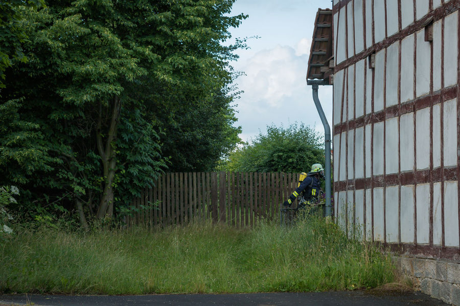 Thank you! Adult Architecture Building Exterior Built Structure Day Fachwerkhaus Fence Fireman Full Length Grass Growth Half Timbered House Half-timbered Lifestyles Nature Nusshain 05 17 One Person Outdoors Real People Respirator The Photojournalist - 2017 EyeEm Awards Tree Volunteer Firefighter Freiwillige Feuerwehr