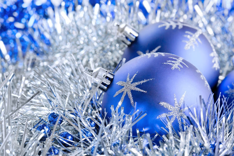 Close-up of christmas ornaments on snow