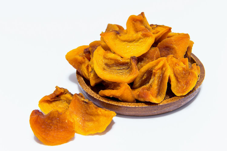 Dried persimmons. Close-up Crunchy Food Food And Drink Freshness Fried Healthy Eating Heap Indoors  No People Potato Chip Ready-to-eat Still Life Studio Shot White Background