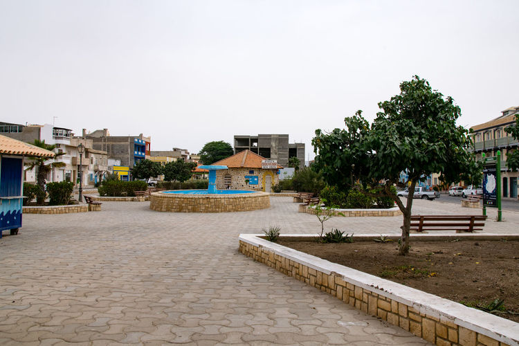 Sal Rei, Boa Vista / Cape Verde - Santa Isabel Square, the main square in Sal Rei which The Church of Santa Isabel (Igreja da Santa Isabel) overlooks Boa Vista Cape Verde Sal Rei Santa Isabel Santa Isabel Square Architecture Boa Vista Beach Boa Vista, Cabo Verde Building Exterior Built Structure Cabo Verde Cabo Verde Africa Clear Sky Day No People Outdoors Sky Tree