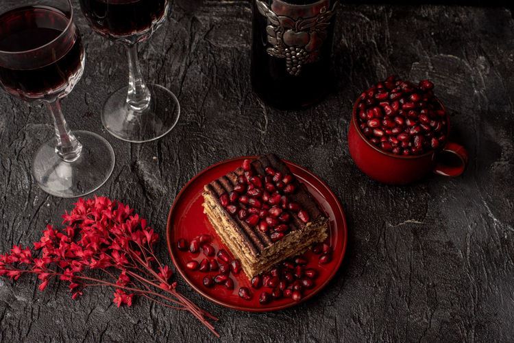 bloody red flowers and seeds of pomegranate, tiramisu and red wine on black stone table Tiramisu Pomegranate Seeds Pomegranate Seed Red And Black Contrasts Temptation Black Table Stone Background Dark Food Photography The Foodie - 2019 EyeEm Awards Red Christmas Christmas Ornament Celebration Fruit Close-up Served Pastry Pie Dessert Indulgence Seed Tropical Fruit