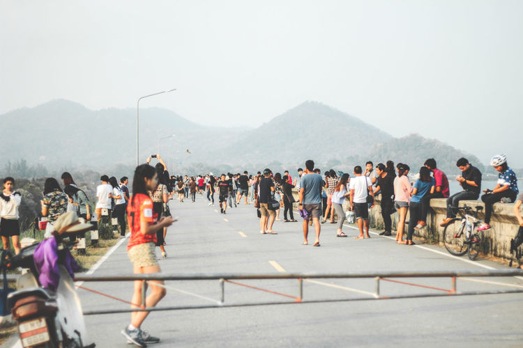 People on road against mountains